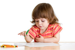 Kid girl drawing with color crayons Stock Photography