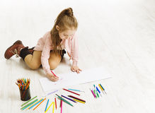 Kid Girl Drawing Color Pencils, Artistic Child Education. Painting on White Floor royalty free stock images