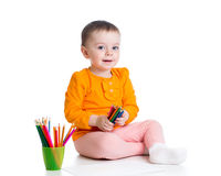 Kid girl drawing with color pencils stock image
