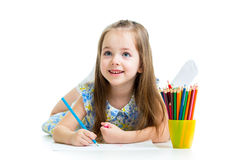 Kid girl drawing with colour pencils Stock Photos