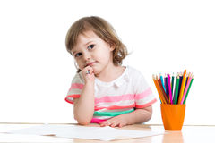 Kid girl drawing with colour pencils Royalty Free Stock Photos