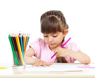 Kid girl drawing with colourful pencils Royalty Free Stock Image