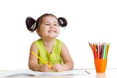 Kid girl drawing with colourful pencils Stock Image