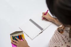 Kid girl drawing Stock Images