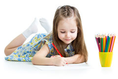 Kid girl drawing with pencils. Kid girl drawing with color pencils stock photo