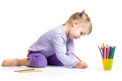 Kid girl drawing with pencils Stock Images