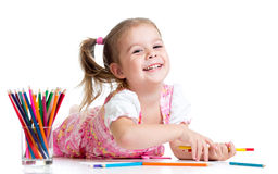 Kid girl drawing with pencils Stock Image