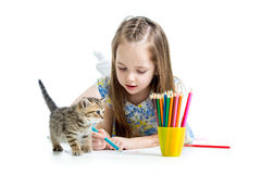 Kid girl drawing with pencils. And kitten stock photo