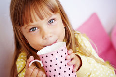 Kid girl drinking milk Stock Photo