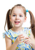 Kid girl drinking yogurt or kefir. Isolated over white Royalty Free Stock Photos