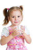 Kid girl drinking yogurt or kefir over white. Background Stock Photography