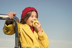 Kid girl eat apple fruit. Healthy diet. Snack while walk. Kids health and nutrition. Healthy snacking benefits. Snack. Between lunch and dinner. Having snack royalty free stock images