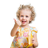 Kid girl eating banana Royalty Free Stock Photos