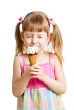 Kid girl eating ice cream isolated Stock Photography