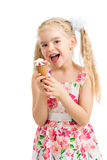 Kid girl eating ice cream isolated Stock Photography