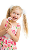 Kid girl eating ice cream isolated Royalty Free Stock Photo