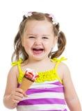 Kid girl eating ice cream isolated Stock Image