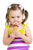 Kid girl eating ice cream isolated Royalty Free Stock Image