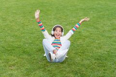 Free Kid Girl Enjoy Music Green Grass Meadow. Happiness Is Not Something You Sit Back And Wait. Listen Music While Relaxing Royalty Free Stock Photo - 179208615
