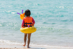 Kid girl enjoying swimming in sea with rubber ring giraffe Royalty Free Stock Images