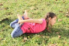 Kid - girl exercising stretching Stock Photos