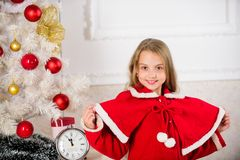 Kid girl festive costume near christmas tree. Childhood happiness concept. Child celebrate christmas at home. Favorite royalty free stock image
