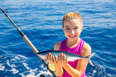 Kid girl fishing tuna bonito sarda fish happy with catch Royalty Free Stock Photos