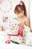 Kid girl with gift boxes Royalty Free Stock Photos