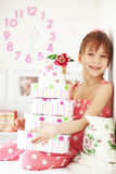 Kid girl with gift boxes Stock Images