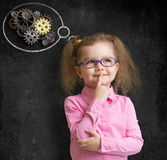 Kid girl in glasses with bright idea standing near Royalty Free Stock Images