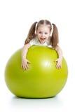 Kid girl with gymnastic ball. Kid girl having fun with gymnastic ball stock photography
