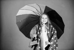 Kid girl happy hold colorful umbrella wear waterproof cloak. Enjoy rainy weather with proper garments. Waterproof. Accessories for children. Waterproof stock photos