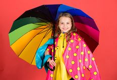 Kid girl happy hold colorful umbrella wear waterproof cloak. Enjoy rainy weather with proper garments. Waterproof. Accessories manufacture. Waterproof stock images