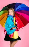 Kid girl happy hold colorful umbrella wear waterproof cloak. Waterproof accessories make rainy day cheerful and pleasant. Confident in her fall garments stock photography