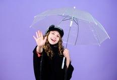 Kid girl happy hold transparent umbrella. Enjoy rainy weather with proper garments. Waterproof accessories make rainy. Day fun. Enjoy rain concept. Fall season stock images