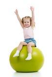 Kid girl with gymnastic ball. Kid girl having fun with gymnastic ball isolated stock image