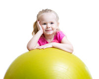 Kid girl having fun with gymnastic ball Stock Photos