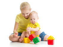 Kid girl and her little brother playing Stock Image