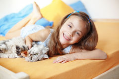 Kid girl with her pet Stock Photos