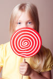 Kid girl holding lollipop Royalty Free Stock Photo