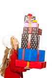 Kid girl holding many gifts stacked on her hand Stock Photography
