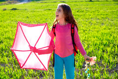 Kid girl holding pink kite in spring meadow. Kid girl holding pink kite traditional in spring on meadow royalty free stock photos