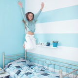 Kid girl jumping on bed Stock Images