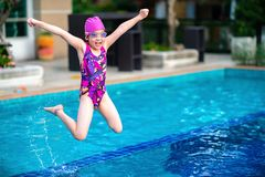 Kid, Girl, Jumping into Swimming Pool with Fun and Happiness Royalty Free Stock Photography