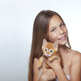Kid girl with kitten royalty free stock photography