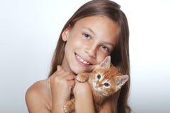 Kid girl with kitten. Portrait of 7 years old kid girl holding small kitten stock images