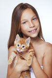 Kid girl with kitten Royalty Free Stock Photos