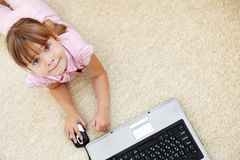 Kid girl with laptop Royalty Free Stock Images