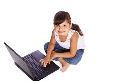 Kid girl with laptop Royalty Free Stock Image