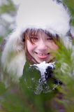Kid girl licking snow portrait closeup Royalty Free Stock Photo
